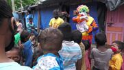 Indian clown educating disadvantaged kids teaches them that COVID is no small feat