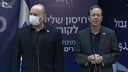 Israel: President Herzog, wife receive anti-COVID booster shots in Tel Aviv