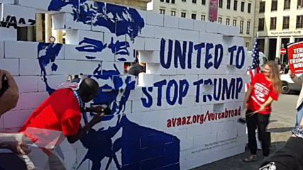 Germany: Activists demolish model wall in protest to Trump's immigration policies