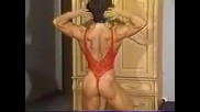 Christa Bauch flexing in red