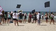 Israel: Protesters rally against second COVID lockdown on Tel Aviv beach