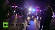 USA: Ferguson protesters face off with police at Mike Brown solidarity rally
