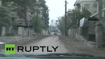 Syria: Mortars almost strike RT crew near Damascus