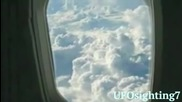 Ufo Sighting Disk Shaped Hovering in the Sky Next to an Airplane