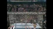 Wwe - Jeff Hardy Скача От Клетка Върху Маса