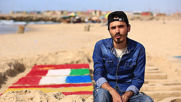 Stay home! Reads Gazan artists' sand sculpture of solidarity for coronavirus victims