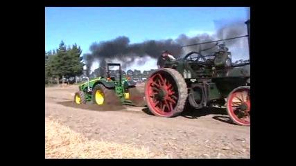 Парен локомотив на колела срещу Трактор Джон Диър