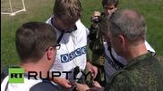 Ukraine: OSCE workers inspect shelling aftermath, alongside DNR's Basurin
