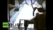 Russia: CSTO troops stage first ever parachute jump onto Arctic ice floes