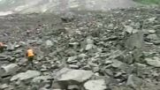 China: Over 100 buried under rubble after landslide hits Sichuan village