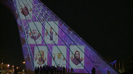 Iran: Tehran's Azadi Tower lit up with messages of solidarity amid coronavirus crisis