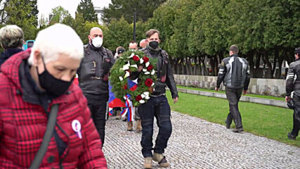 Czech Republic: Night Wolves supporters lay flowers at WWII memorial in Prague