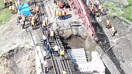 Russia: Collapsed Trans-Siberian railway bridge being restored after floods in Trans-Baikal