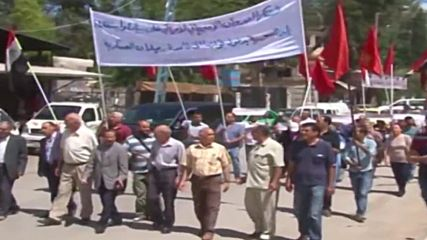 Syria: US flag burns as Communist Party supporters decry US presence in Rmelan