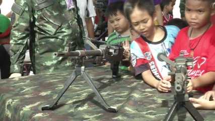 Thailand: Kids play with army weaponry on Children's Day