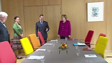 Belgium: Medvedev and Merkel discuss economic cooperation at ASEM