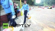 Nepal: Police officers show their love for dogs in Tihar celebrations