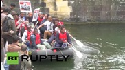 France: Migrant protesters paddle to parliament to protest Western wars
