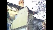 Работници Събарят Стена На Къща