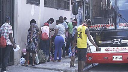Honduras: Haitian migrants pass through Comayaguela on route to US