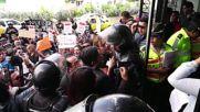 Ecuador: Cuban migrants arrive at Quito court for deportation hearing