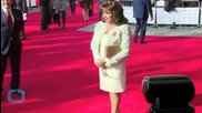 Joan Collins, 81, Becomes a Dame and Rocks Regal Look at Palace, Celebrates With Family and Delicious Treat
