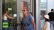 Greece: Banks reopen after three-week shutdown, capital controls remain