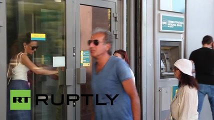 Greece: Banks reopen after three-week shutdown, capital controls remain