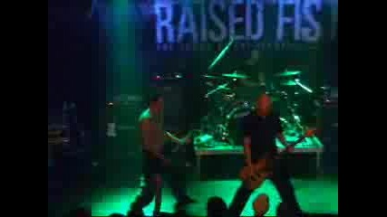 Raised Fist - Working On Wood