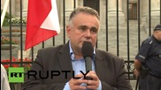Poland: Anti-Russian protesters wave Ukrainian flags outside Warsaw embassy