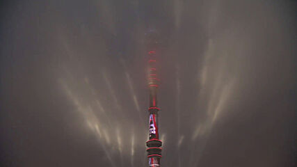 Russia: Moscow's Ostankino Tower lit up in honour of 76th V-Day