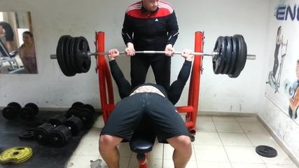 210 kg