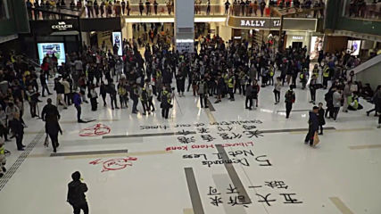 Hong Kong: Protesters smash woman's phone after she won't delete mall demo images