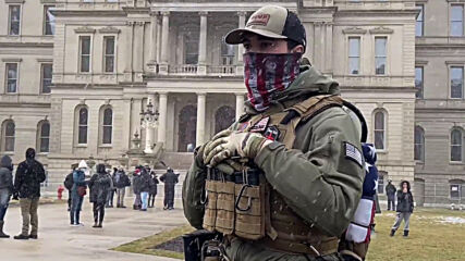 USA: Small group of armed protesters rallies in front of Michigan Capitol