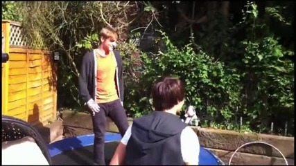 Big time rush jumping on a trampoline