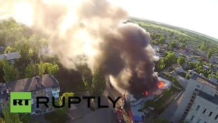 Ukraine: Drone captures Donetsk market aflame after shelling attack