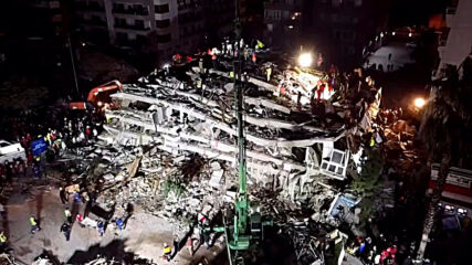 Turkey: Drone footage shows rescue efforts underway after earthquake topples building in Izmir province
