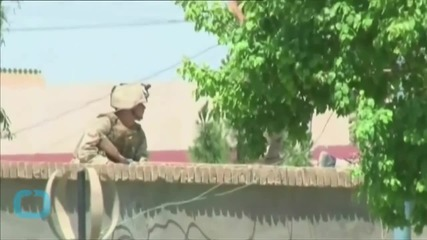 Afghan Official: 19 Police, 7 Soldiers Dead in Ongoing Siege