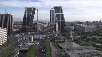 Spain: Greenpeace hang anti-TTIP banner on Madrid's Gate of Europe towers