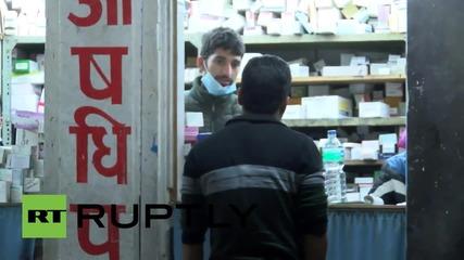 Nepal: Bodies & the injured pile pressure on Kathmandu's Bir Hospital *GRAPHIC*