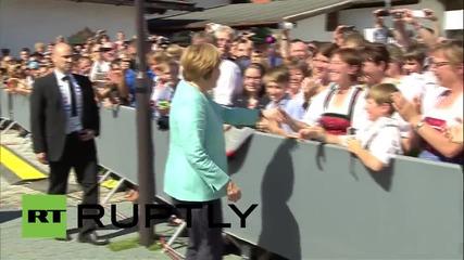 Germany: Merkel arrives to Bavarian festival in Krun for bilateral meeting with Obama