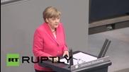 """Germany: Merkel heckled by Die Linke in Greece """"solidarity"""" speech"""