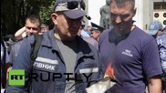 Ukraine: Firefighters burn their uniforms in labour rights protest