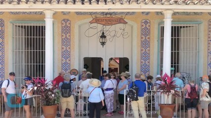 Tourists Flock to See Cuba Before the Floodgates Open