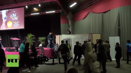France: Topless Femen dragged off stage at Muslim conference *EXPLICIT*