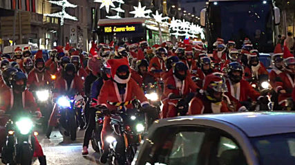 Spain: No sleigh! Thousands of gift-laden biker Santas flood Barcelona