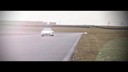 Porsche Cayman R and Bmw 1-series M Coupe drifting sideways