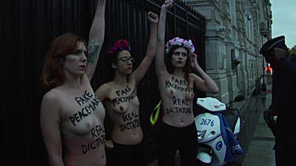France: Topless FEMEN activists protest in Paris ahead of WWI armistice centenary *EXPLICIT*