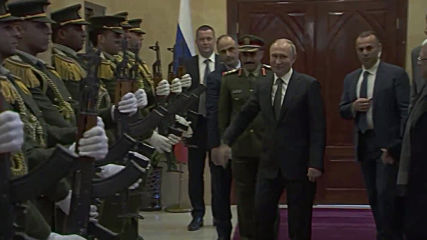 Hats off to Putin! Russian president picks up soldier's fallen cap
