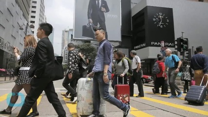 China Restricts Travel of Locals to Hong Kong to Cool Tensions